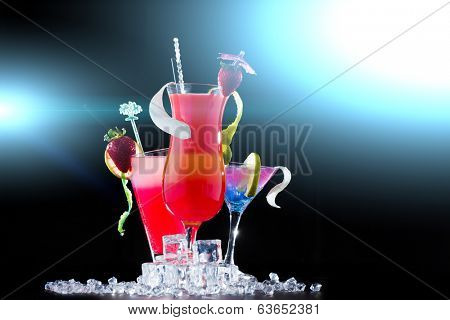 Party time - Fresh strawberry cocktail over black background
