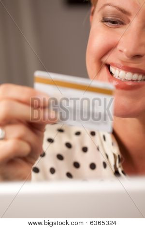 Beautiful Woman Using Laptop Holding Her Credit Card