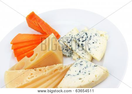 aged parmesan roquefort and gruyere chops delicatessen cheeses and slices on plate isolated over white background
