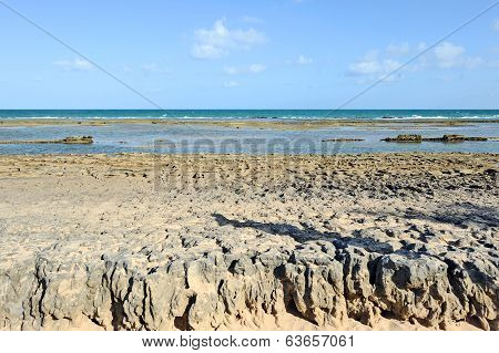 A sunny beach with layers of water