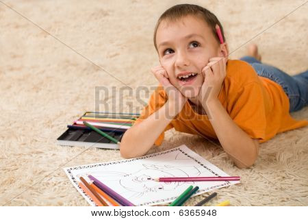 Kid With Pencils On The Carpet.