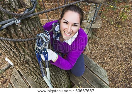 Woman climbing in adventure park