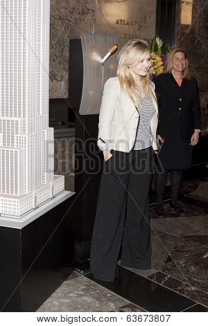 NEW YORK-APR 21, 2014: Actress & Project Sunshine Ambassador Abigail Breslin poses after flipping the switch to light the Empire State Building in yellow in honor of Project Sunshine Month.