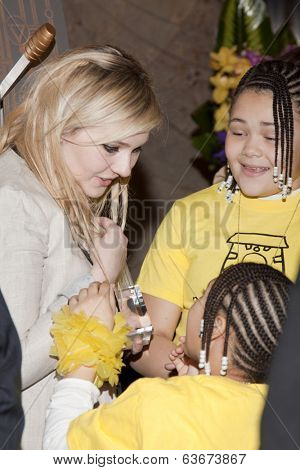 NEW YORK-APR 21, 2014: Unidentified children from Project Sunshine meet Actress Abigail Breslin at the ceremony to light the Empire State Building in yellow in honor of Project Sunshine Week.