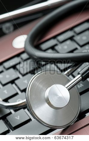 close up of a stethoscope and a computer keyboard
