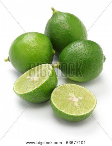 fresh key limes on white background