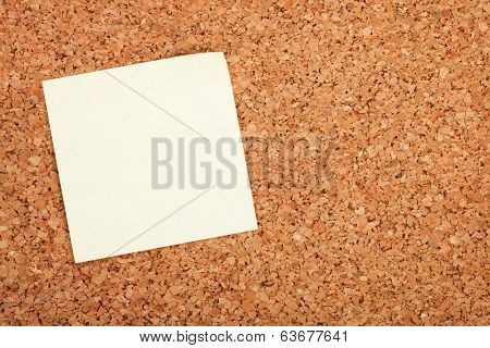 Blank postit note on cork wood notice board with copy space