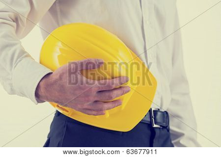 Businessman Holding A Yellow Hardhat