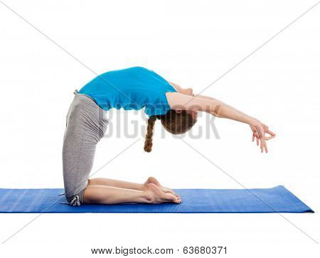 Yoga - young beautiful slender woman yoga instructor doing advanced variation of camel pose (Ustrasana) asana exercise isolated on white background