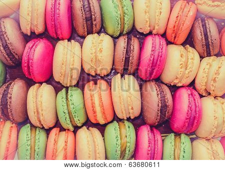 Colourful tasty macaroons in a row