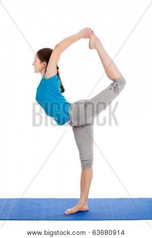 Yoga - young beautiful slender woman yoga instructor doing Lord of the Dance Pose (Natarajasana) asana in ashtanga vinyasa style exercise isolated on white background