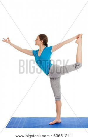 Yoga - young beautiful slender woman yoga instructor doing Lord of the Dance Pose (Natarajasana) asana exercise isolated on white background