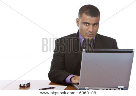 Businessman Works On Laptop In Office