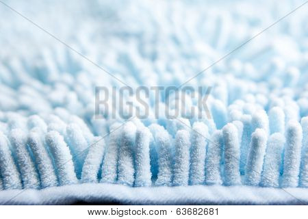 high magnification macro of blue high absorbent fabric or carpet, pile section.