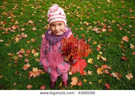 Girl With A Bunch Of Leaves