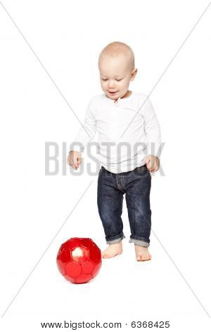 Boy Playing With A Red Ball