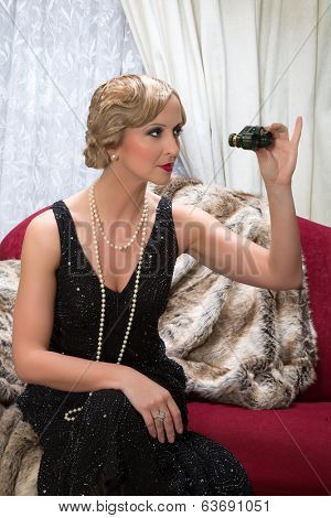 Classy flapper dress lady holding a pair of opera glasses in a roaring twenties scene