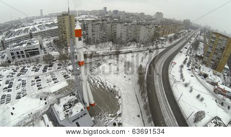 RUSSIA, SAMARA - JAN 4, 2014: Aerial view to monument rocket stands at mountain top against city landscape of Samara.