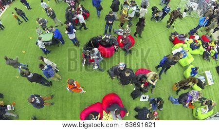 MOSCOW, RUSSIA - JAN 25, 2014: Aerial view to children and adult people at largest European festival of modern technology, science and art Geek Picnic.