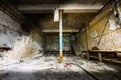 pic of locksmith  - an old empty desolate dirty locksmith workshop poor light - JPG
