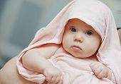 newborn baby girl portrait in cover after bathe