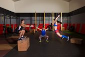 stock photo of slam  - gym people group workout barbells slam balls and jump exercises - JPG