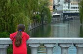 picture of tourist-spot  - A tourist girl enjoying the serene canal views at a quiet spot Ljubljana Slovenia - JPG