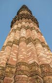 picture of qutub minar  - Qutub minar in center of the vertical frame. Main column is in focus.