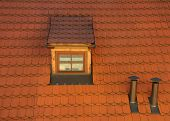 pic of gabled dormer window  - Photo of an Attic Dormer on a Red Tile Roof with Chimney Stacks - JPG