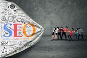stock photo of pulling  - Portrait of business people pulling SEO banner - JPG