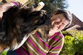 image of working-dogs  - disabled woman sitting outdoors with an half breed dog - JPG