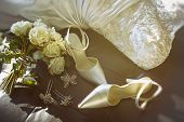 picture of ceremonial clothing  - Wedding shoes with bouquet of white roses  on chair - JPG