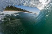 pic of hollow  - Ocean wave crashing on shallow reefs with water power and energy of nature - JPG