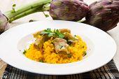 stock photo of artichoke hearts  - white dish with Italian Risotto With Artichok - JPG