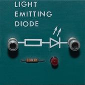 picture of diodes  - A red Light Emitting Diode on a green block - JPG