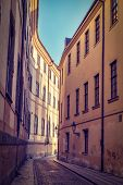 Vintage retro hipster style travel image of Prague street with old houses, Prague, Czech Republic