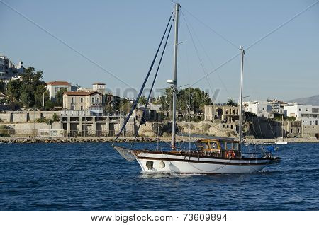 Tradinional wooden cruise boat near coastline