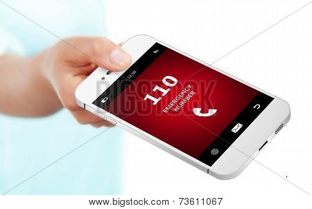 Hand Holding Mobile Phone With Emergency Number 110