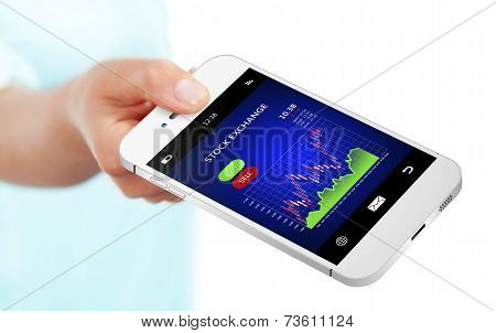 Hand Holding Mobile Phone With Stock Exchange Chart Over White