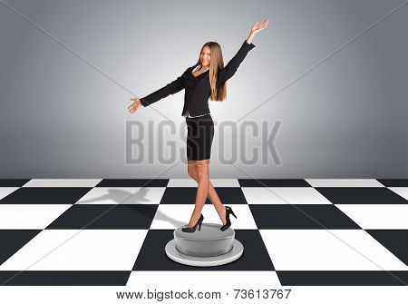 Beautiful businesswoman posing and looking into camera