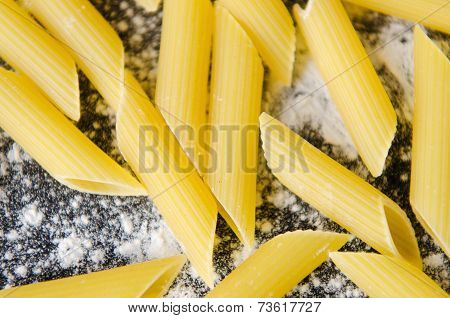 Pasta With Flour On A Dark Table