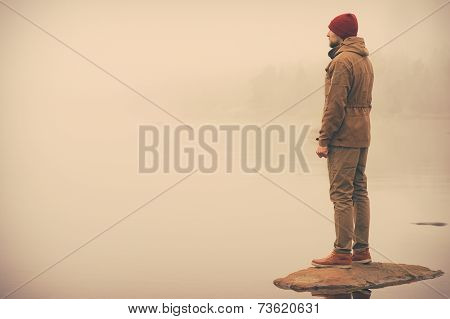 Young Man standing alone outdoor Travel Lifestyle