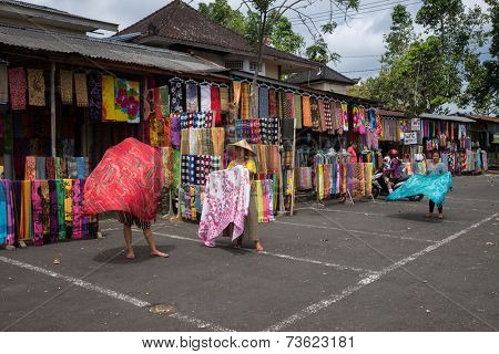 BALI, INDONESIA - SEPTEMBER 20, 2014: Vendors display sarong wraps for sale or rental to tourist visiting the Besakih Temple Complex.