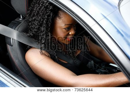 Young African Woman Driving A Car