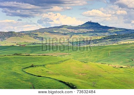 Tuscany, Radicofani Village, Farmland And Green Fields. Val D Orcia, Italy.