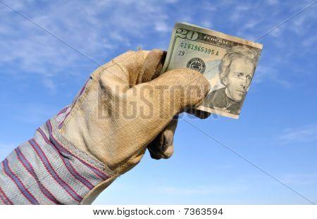 Worker Holding A Twenty Dollar Bill