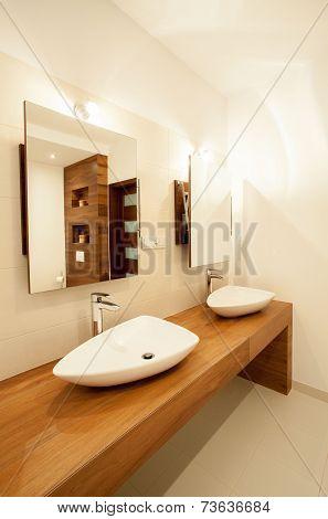 Porcelain Sinks On Wooden Counter