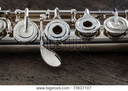 Modern Concert Flute On A Wood Table