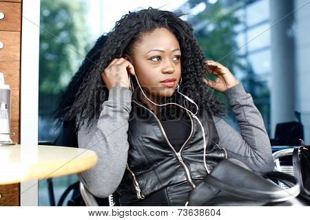 Curly Black Woman Listening Music Using Headphone