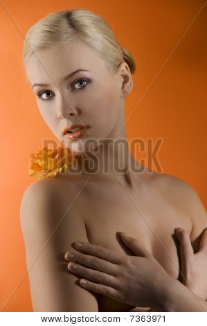 Blond Girl With Orange Flower